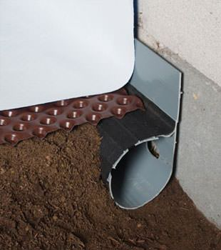 Closeup of a crawl space drainage system installed in Santa Clarita